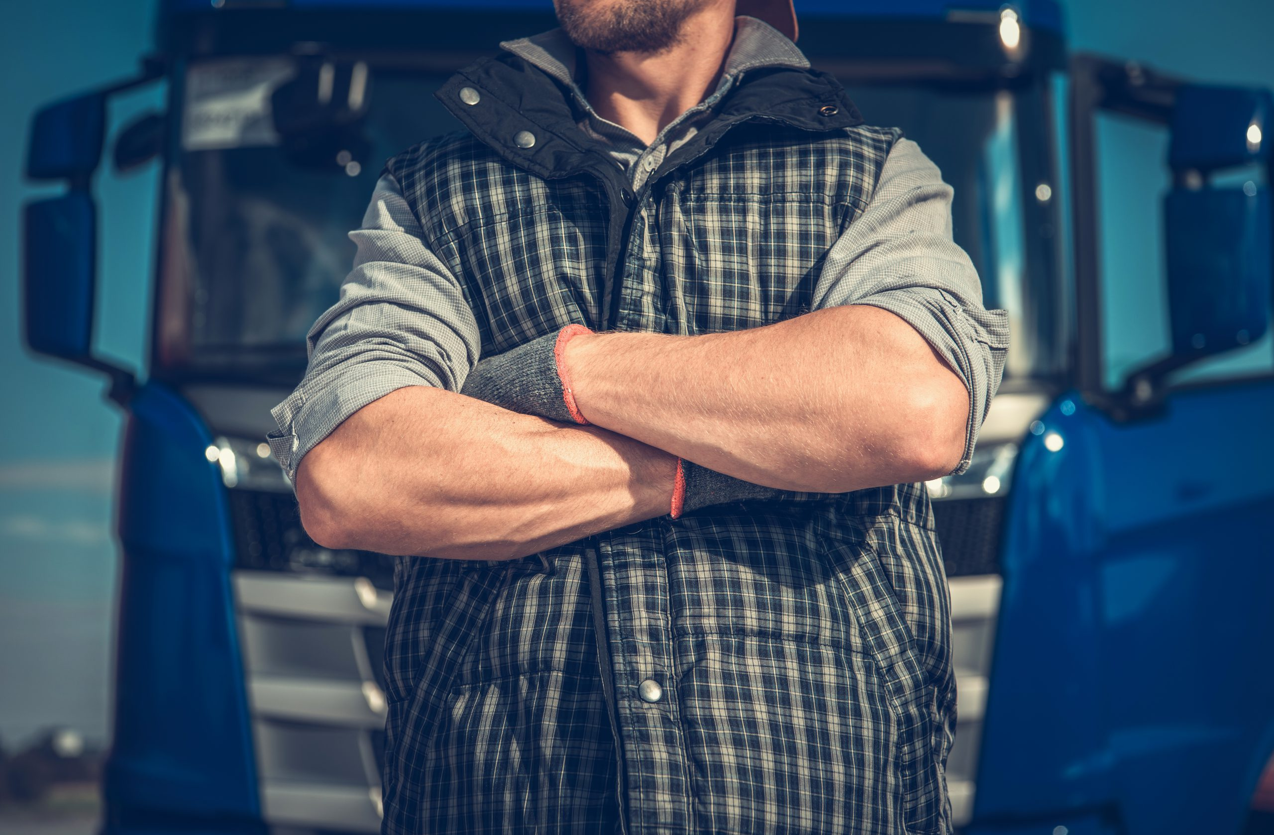 man standing in front of a truck